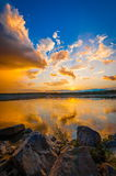 Sunset/sunrise over river Royalty Free Stock Images