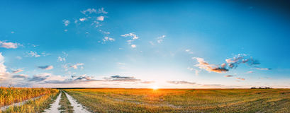 Sunset, Sunrise Over Rural Meadow Field And Country Road. Countryside Stock Image