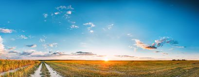 Sunset, Sunrise Over Rural Meadow Field And Country Road. Countryside. Sunset, Sunrise Over Rural Meadow Field And Country Open Road. Countryside Landscape With Royalty Free Stock Images