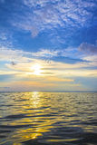 Sunset sunrise over the sea and clouds, beautiful sky Stock Image