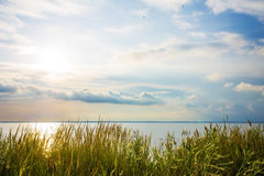 Sunset sunrise over the sea and clouds, beautiful sky Royalty Free Stock Photography