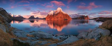 Sunset or sunrise panoramic view on stunning mountains in Lofoten islands, Norway, Mountain coast landscape, Arctic circle. Long exposure of a magic sunrise royalty free stock images