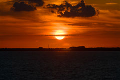 Sunset sunrise red orange yellow sky sun clouds cloud Royalty Free Stock Image