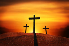 Three Crosses with Clipping Path. A sunset or sunrise scene of three crosses on a hill. backlit by the sun. vignett Royalty Free Stock Photo
