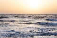 Sunset sunrise on the sea with beautiful waves Stock Image