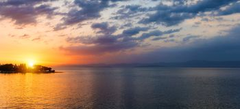 Sunset or sunrise sky above the sea. Nature, weather, atmosphere, travel theme. Sunrise or sunset over the sea. Panorama royalty free stock photo