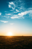 Sunset, Sunrise, Sun Over Rural Countryside Field. Bright Blue And Yellow Royalty Free Stock Photos