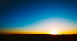 Sunset, Sunrise, Sun Over Rural Countryside Field Royalty Free Stock Photo