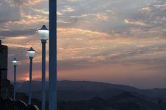 Sunset and sunrise view from mountains with street lights. And buildings royalty free stock photo