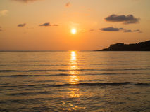 Sunset sunshine reflect on the sea water in the evening Royalty Free Stock Images