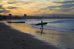 Sunset Surf. Surfing at Sunset Stock Images