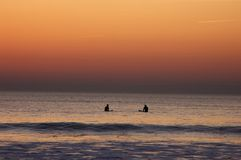 Sunset surf Stock Images