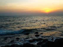 Sunset and surf in the evening of vocation stock images