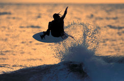 Sunset Surfer 1. A surfer catches air during an evening session Royalty Free Stock Image