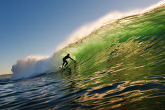 Sunset Surfer. Surfer on Wave at Sunset in California Royalty Free Stock Photography