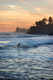 Sunset Surfer. Person surfing at sunset in California royalty free stock photos