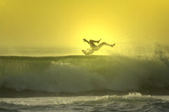 Sunset surfer falling stock image