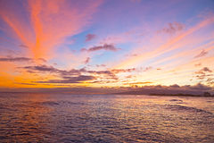 Sunset on a surfing beach in Honolulu, Hawaii. Royalty Free Stock Image