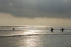 Sunset surfing at kuta beach. Stock Photo