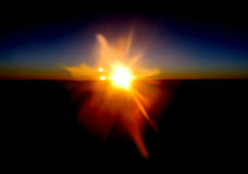 Sunset Surprise v1. Sunset Surprise was captured at 20000 feet altitude above the Canadian Skies near Calgary Stock Photo