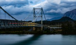 Sunset on the Suspension Bridge. Photograph of the Landscape in the sunset of the hanging bridge over the river Mayer of Villa Ohiggins. Austral road. Chili royalty free stock photos