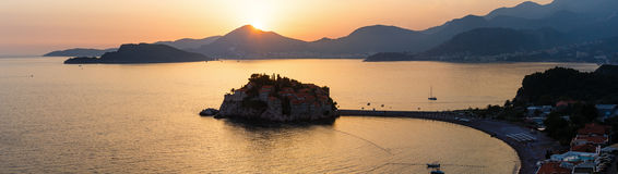 Sunset and Sveti Stefan sea islet (Montenegro) Royalty Free Stock Photos
