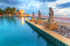Sunset at swimming pool. In Thailand Stock Image