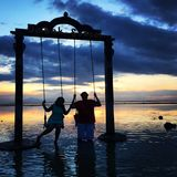 Sunset swings in gili travangan Stock Photography