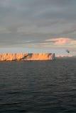 Sunset with tabular iceberg Royalty Free Stock Images