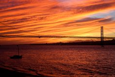 Sunset on the Tagus River. A blazing red sunset over the Tagus River. Lisbon, Portugal Royalty Free Stock Photos