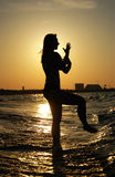 Sunset Tai Chi on a beach Stock Images