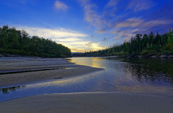 Sunset on the taiga river in Siberia Stock Photography