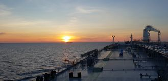 Sunset on a tanker. stock photos
