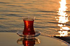 Sunset and Tea Royalty Free Stock Images