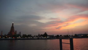 Sunset, Temple of the Dawn in Bangkok, Thailand, Chao Phraya River. twilight moment of famous skyline. Wat Arun at Sunset, Temple of the Dawn in Bangkok stock footage