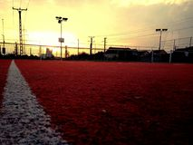 Sunset tennis court. The sun set over the tennis court royalty free stock photo