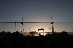 Sunset tennis court. Sun setting over a tennis court Stock Photo