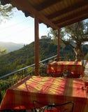 Sunset on the terrace Greek taverna Royalty Free Stock Image