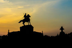 Sunset of Thai King statue monument in Ayutthaya Royalty Free Stock Photography