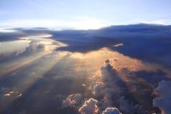 Sunset though clouds stock photos