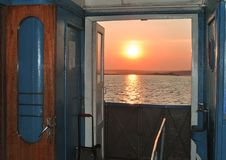 Sunset throw the open Doors on a ship royalty free stock images