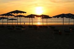 Sunset thru Parasols Stock Photography