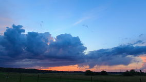 Sunset and thunderstorms. Lightning flashed. Time