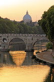 Sunset on the Tiber and Saint Peter, Rome. Sunset on the Tiber, the river of Rome, and it's bridges with Saint Peter in the background Stock Photos