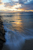 Sunset tide. Motion blurred tide on sunset beach Royalty Free Stock Photos