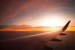 Sunset time with airplane wing from the inside, Travel in Thaila Stock Image