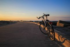 Parking bike at beach way. Sunset time at beach road and bicycle parking without owner Stock Image