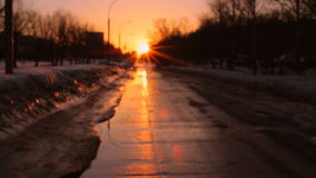 Sunset time at the city. Spring winter time, wet road stock footage