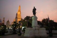 Sunset time at King Rama II Monument and main Prang ofWat Arun Ratchawararam Ratworamahawihan Temple of Dawn . Stock Image