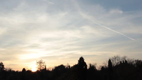 Sunset time lapse with blue sky and moving clouds. Beautiful sunset time lapse with blue sky and moving clouds over forest stock footage